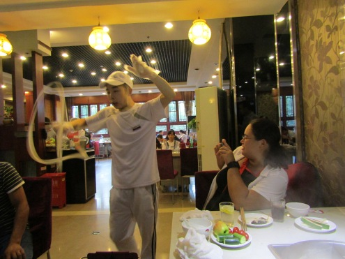 Noodle dancer at Haidilao hot pot in Xian