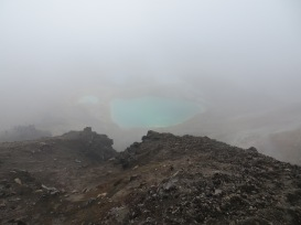 Emerald lakes peaking through Tongariro Alpine Crossing