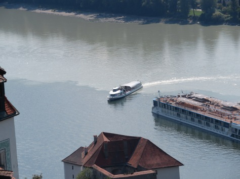 Two of three rivers merge in Passau, Germany.